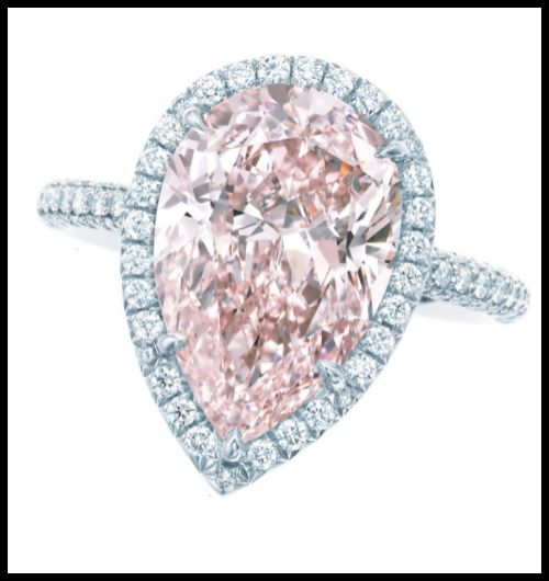 Pink diamond and diamond ring by Tiffany and Co. A pear-shaped 2.11ct fancy intense pink diamond, surrounded by a single row of white diamonds set in platinum.
