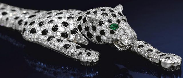 The Duchess of Windsor's Cartier panther bracelet. The fully-articulated piece is pavé-set with brilliant- and single-cut diamonds and calibré-cut onyx. It was made by Cartier in 1952.