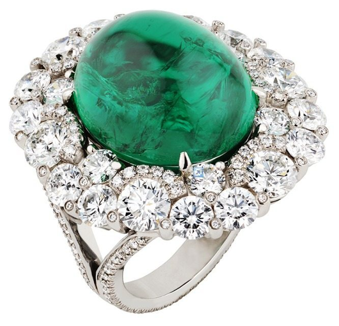 The Fabergé Solyanka cabochon emerald and diamond ring. Centered by a 14.50ct cabochon-cut emerald, set in platinum and set with 263 white diamonds. Via Diamonds in the Library.