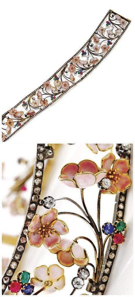 A antique Art Nouveau cherry blossom choker with diamonds, rubies, sapphires, and emeralds.