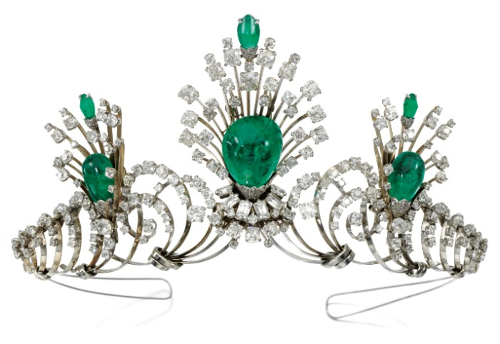 A convertible emerald and diamond tiara, with emerald drops that detach and can be worn as a brooch and earrings.