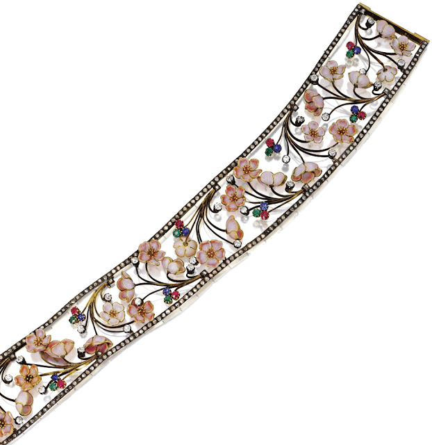 An Art Nouveau cherry blossom choker with diamonds, rubies, sapphires, and emeralds. By Emile Froment-Meurice, circa 1900. Via Diamonds in the Library.