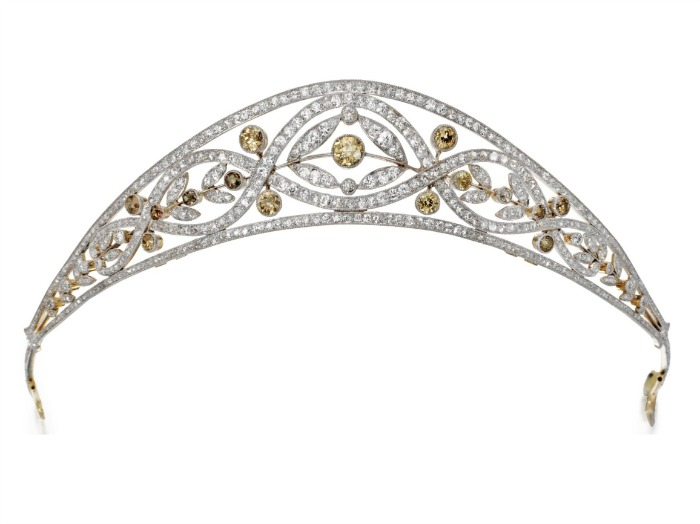 An antique Edwardian tiara, circa 1910. With 6.50 carats of white single-cut and rose-cut diamonds and 3.25 carats colored old-cut diamonds, in gold and platinum.