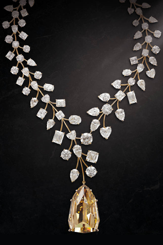 Mouawad's record-breaking L'Incomparable diamond necklace; a 407.48 carat, internally flawless natural fancy deep yellow diamond set with 637 carats of smaller diamonds.