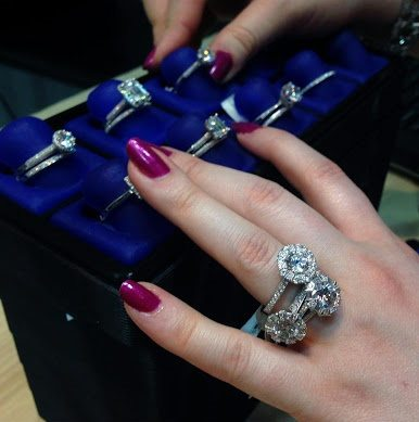 Becky of Diamonds in the Library dives into a box of Tacori diamond engagement rings at the Merivs Diamond trunk show.
