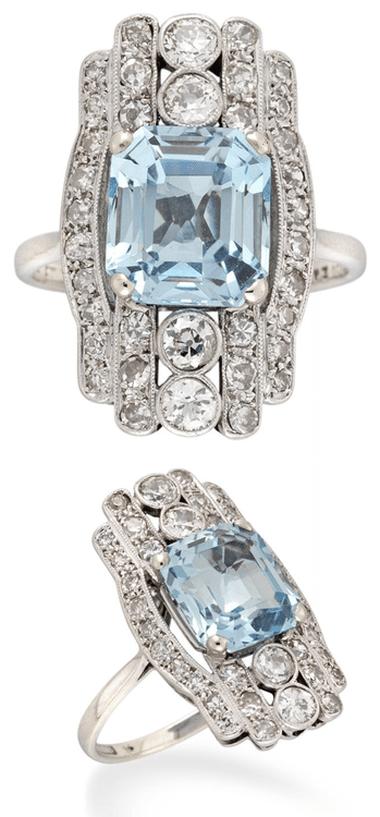 Late Art Deco ring with a 3.22 carat aquamarine set within a fancy diamond set surround, millegrain-set to a pierced mount hallmarked 18 carat white gold. Via Diamonds in the Library.