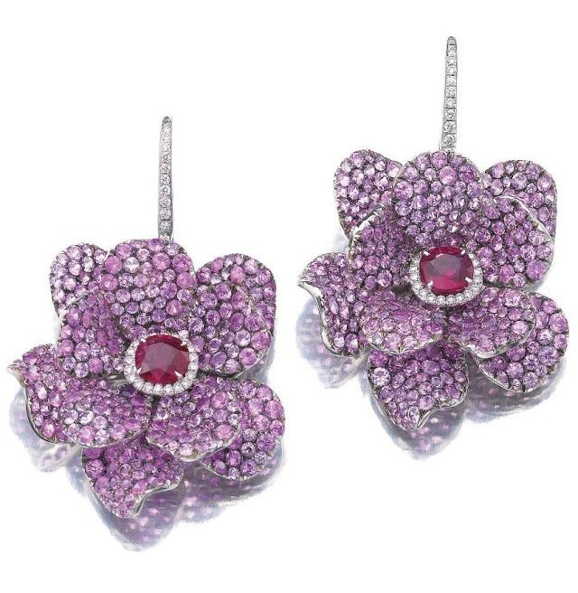 Ruby, sapphire, and diamond earrings by Michele della Valle. With pavé-set with circular-cut pink sapphires, cushion-shaped rubies, and brilliant-cut diamonds.