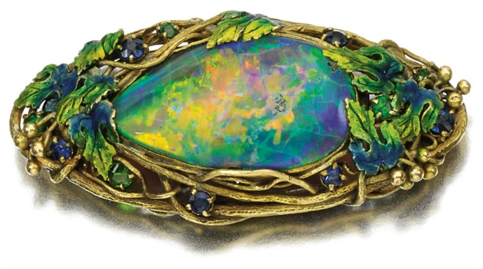Art Nouveau opal, sapphire, garnet, and enamel brooch by Louis Comfort Tiffany for Tiffany & Co., circa 1910. Via Diamonds in the Library.