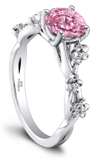 The Leah diamond engagement ring by Jeff Cooper. This unique design features a cherry blossom design along the band and can have any center stone. Via Diamonds in the Library.
