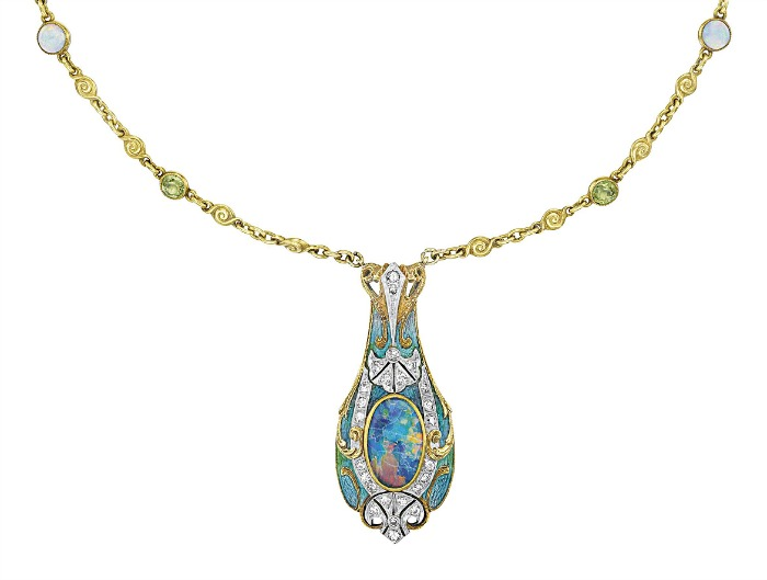 An Art Nouveau opal necklace by Tiffany and Co. A gold, enamel, and black opal pendant on a peridot and white opal-studded gold chain. Circa 1900.
