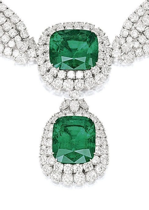 Detail - an emerald and diamond necklace, by Cartier. This piece features two large emeralds (44.42 and 42.50 carats) surrounded by 75 carats of diamonds.Via Diamonds in the Library.