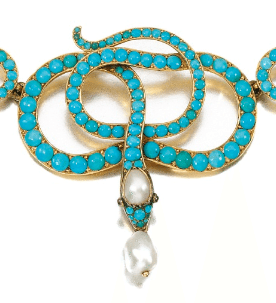Detail view of a 19th century turquoise, ruby, and pearl snake necklace. Victorian era. Via Diamonds in the Library.
