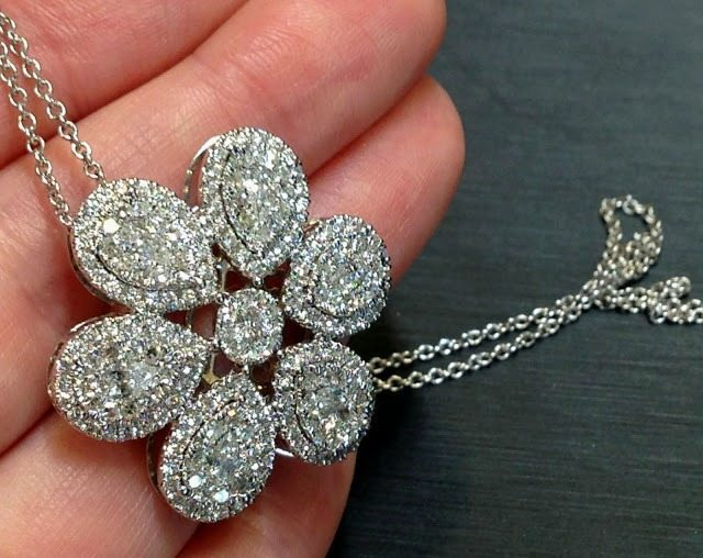 Floral diamond pendant necklace by Martin Flyer. Via Diamonds in the Library.