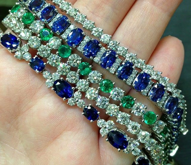 Sapphires, emeralds, and diamonds sparkle in these bracelets by Coast Diamond. Via Diamonds in the Library.