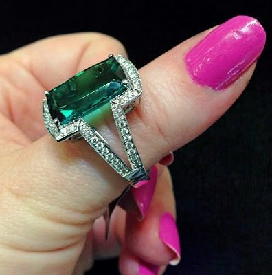 A green tourmaline and diamond cocktail ring by Coast Diamond. Via Diamonds in the Library.