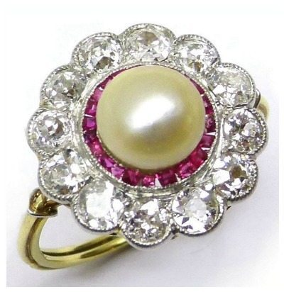 Antique pearl, ruby, and diamond ring; French, circa 1905. With calibre cut rubies and old cut diamonds. Via Diamonds in the Library.