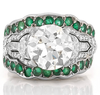 Art Deco style emerald and diamond inset ring. Centers an old European-cut diamond (approximately 3.14 carats), flanked diamonds and emeralds.