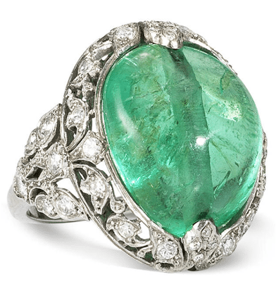 Art Nouveau emerald and diamond ring with a large cabochon emerald wreathed in platinum and diamond leaves.