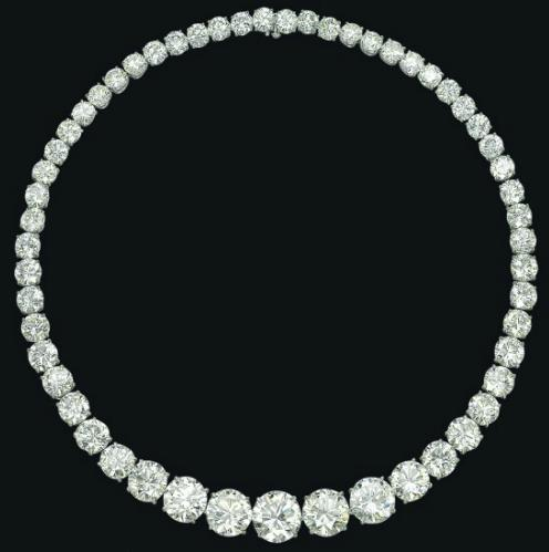 Magnificent diamond rivere necklace set with fifty-five graduated brilliant-cut diamonds, weighing approximately 117.31 carats in total, and mounted in platinum. Via Diamonds in the Library.