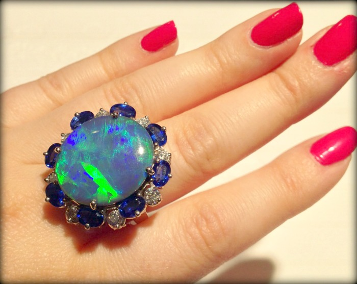 An opal, sapphire, and diamond ring by Oscar Heyman. Via Diamonds in the Library.