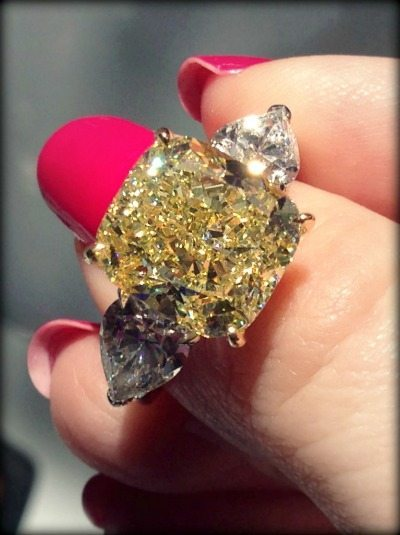 Diamond and yellow diamond engagement ring by Oscar Heyman. Via Diamonds in the Library.