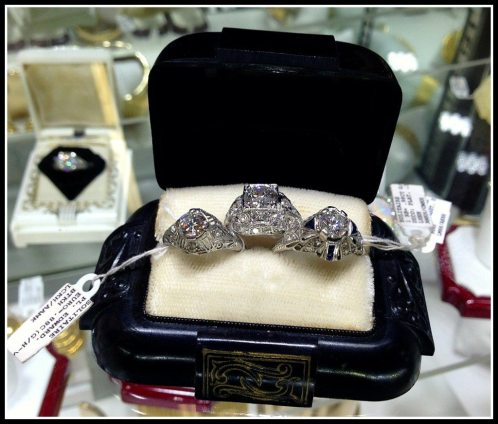 Antique Art Deco diamond engagement rings, one with sapphire. At Scott Antique Market. Via Diamonds in the Library