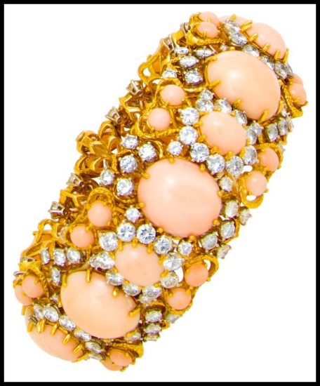 Alternate view: A gold, coral, and diamond bracelet. Via Diamonds in the Library.