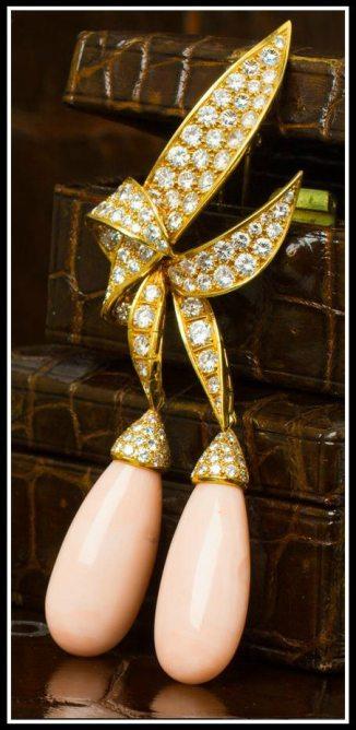 A gold, coral, and diamond pendant. Via Diamonds in the Library.