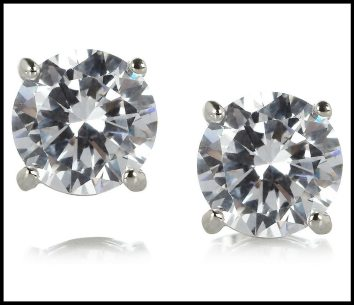 Kenneth Jay Lane rhodium-plated cubic zirconia earrings. Via Diamonds in the Library's jewelry gift guide.