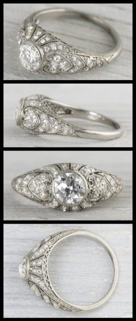 Antique 1.63 carat Art Deco engagement ring from 1920. Center diamond is .80 carats and is accented by single cut diamonds encrusted in a very ornamental setting rich with millegrain edges. Via Diamonds in the Library.
