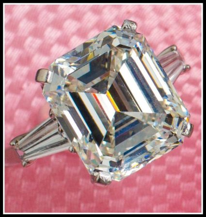 Alternate view: Diamond engagement ring with a 10.48 carat cut-cornered rectangular-cut diamond flanked on either side by a tapered baguette-cut diamond. Via Diamonds in the Library.