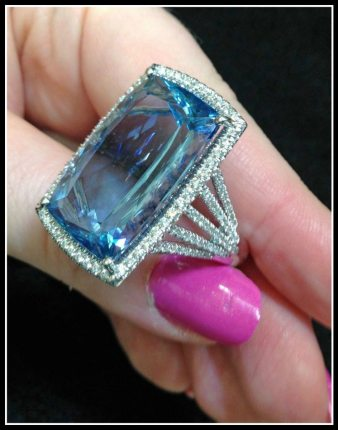 An aquamarine and diamond ring by Coast Diamond. Via Diamonds in the Library.