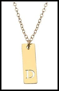 Miriam Merenfeld Extra Small Vertical Bar Initial Pendant Necklace. Via Diamonds in the Library's jewelry gift guide.