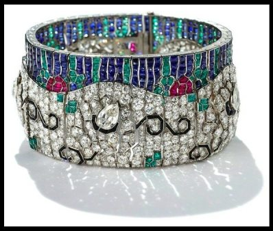 "Art Deco diamond and multi-gem ""wave"" bracelet by Rubel Freres. Circa 1925. Via Diamonds in the Library."