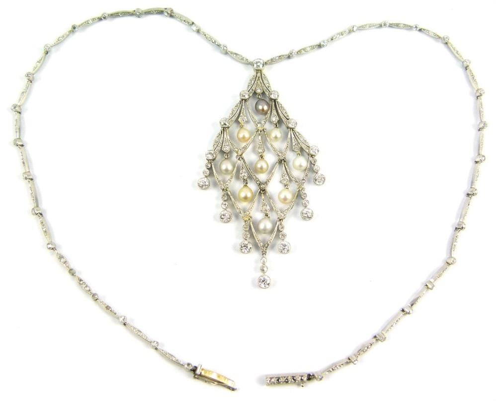 Edwardian diamond and pearl lozenge-shaped necklace, circa 1905. Via Diamonds in the Library.