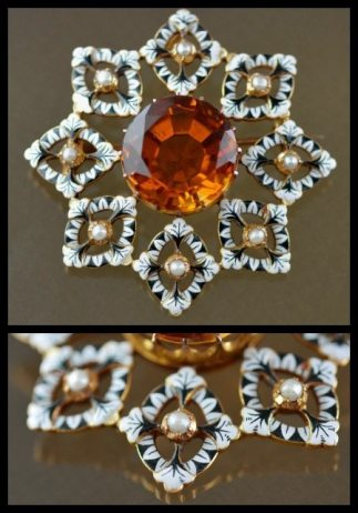 Renaissance-revival Giuliano brooch featuring a large orange zircon surrounded by enamel and pearls. Via Diamonds in the Library.