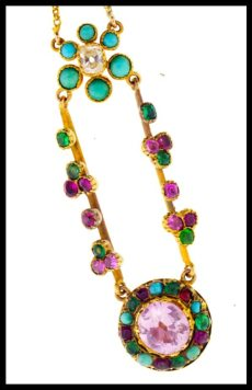 Victorian pendant necklace with emeralds, turquoise, and rubies set in gold. Via Diamonds in the Library.