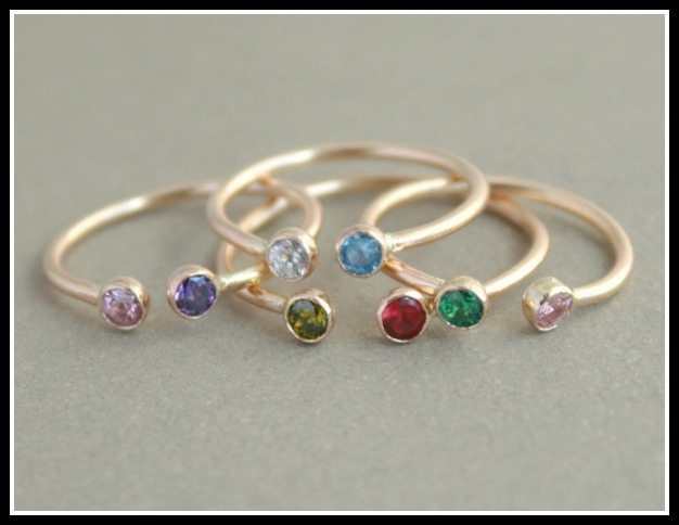 These gold and gemstone rings are meant to be set with your birthstone and the birthstone of someone you love. Via Diamonds in the Library.