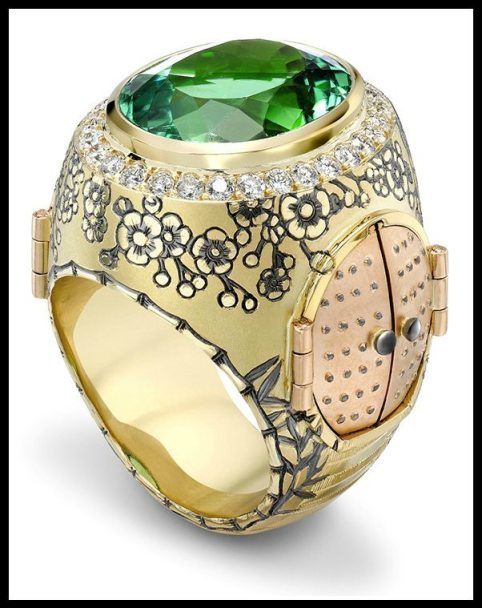 Chinese Secret Garden Ring by Theo Fennell; engraved yellow and rose gold with diamonds, a 12.53ct green tourmaline, and enamel. Via Diamonds in the Library.