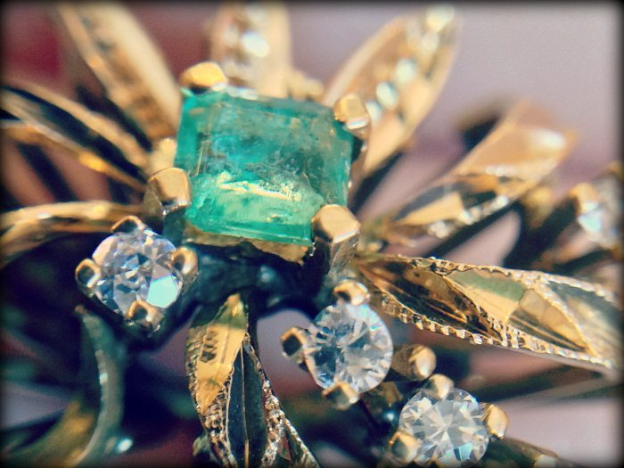 Emerald and diamond retro ring. Via Diamonds in the Library.