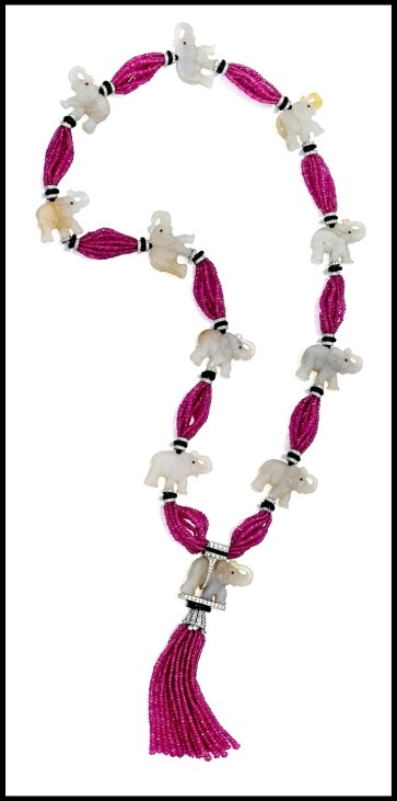 Jade, ruby bead, onyx, and diamond elephant necklace by Michele della Valle. Via Diamonds in the Library.