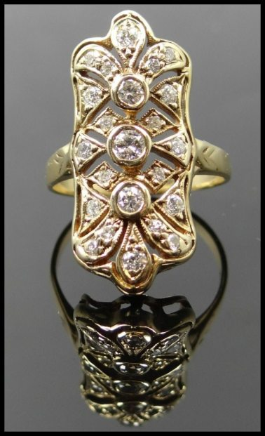Antique Art Deco gold and diamond ring. Via Diamonds in the Library.