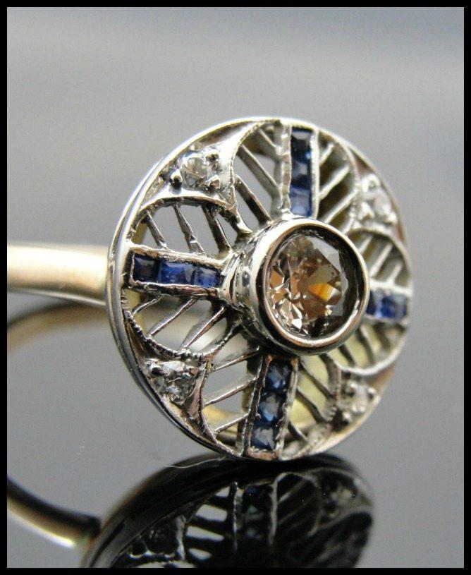 Art Deco sapphire and diamond ring with spiderweb filigree. Via Diamonds in the Library.