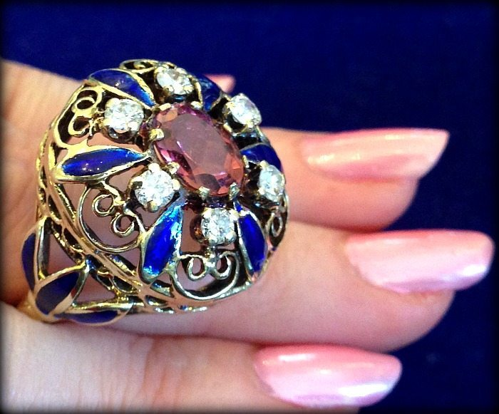 Vintage enamel and pink tourmaline ring. Via Diamonds in the Library.