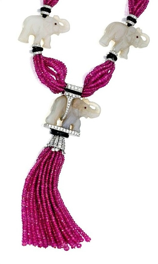 Tassel detail; Jade, ruby bead, onyx, and diamond elephant necklace by Michele della Valle. Via Diamonds in the Library.
