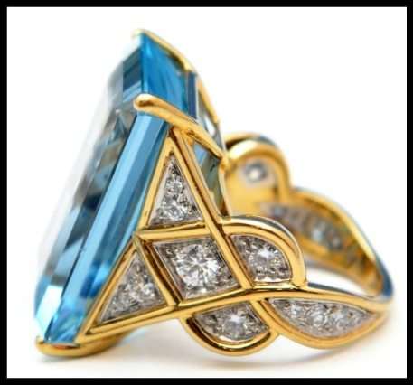 Side view: Aquamarine and diamond ring by Cartier. This piece features a 28.50 carat aquamarine and diamonds in 18k gold. Via Diamonds in the Library.