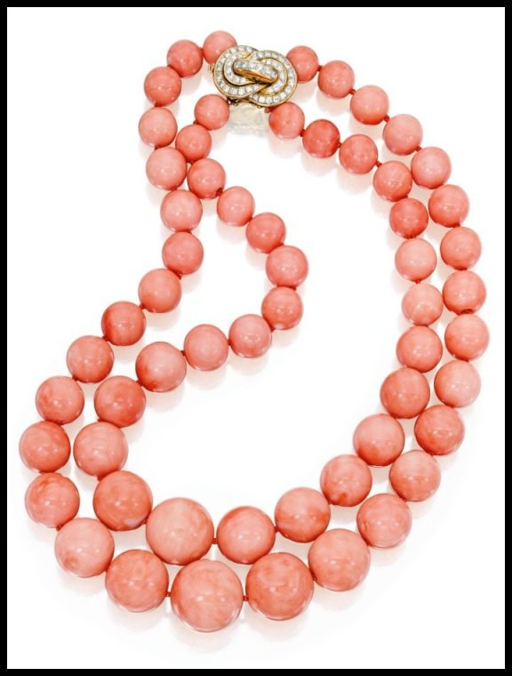 Gold, coral bead, and diamond necklace. Via Diamonds in the Library.