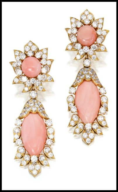 Coral, diamond, and 18 karat gold earrings by Van Cleef and Arpels. Via Diamonds in the Library.