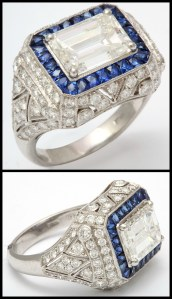 Art Deco-inspired contemporary ring with a 3 carat emerald-cut diamond within a ring of sapphires and on a diamond-encrusted geometric Art Deco-style setting. Via Diamonds in the Library.
