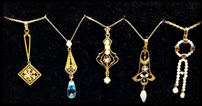 Antique gold lavalier necklaces with pearls and gemstones.